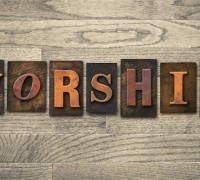 "The word ""WORSHIP"" written in vintage wooden letterpress type."