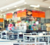 Defocused and blur image of food court, vintage color tone.